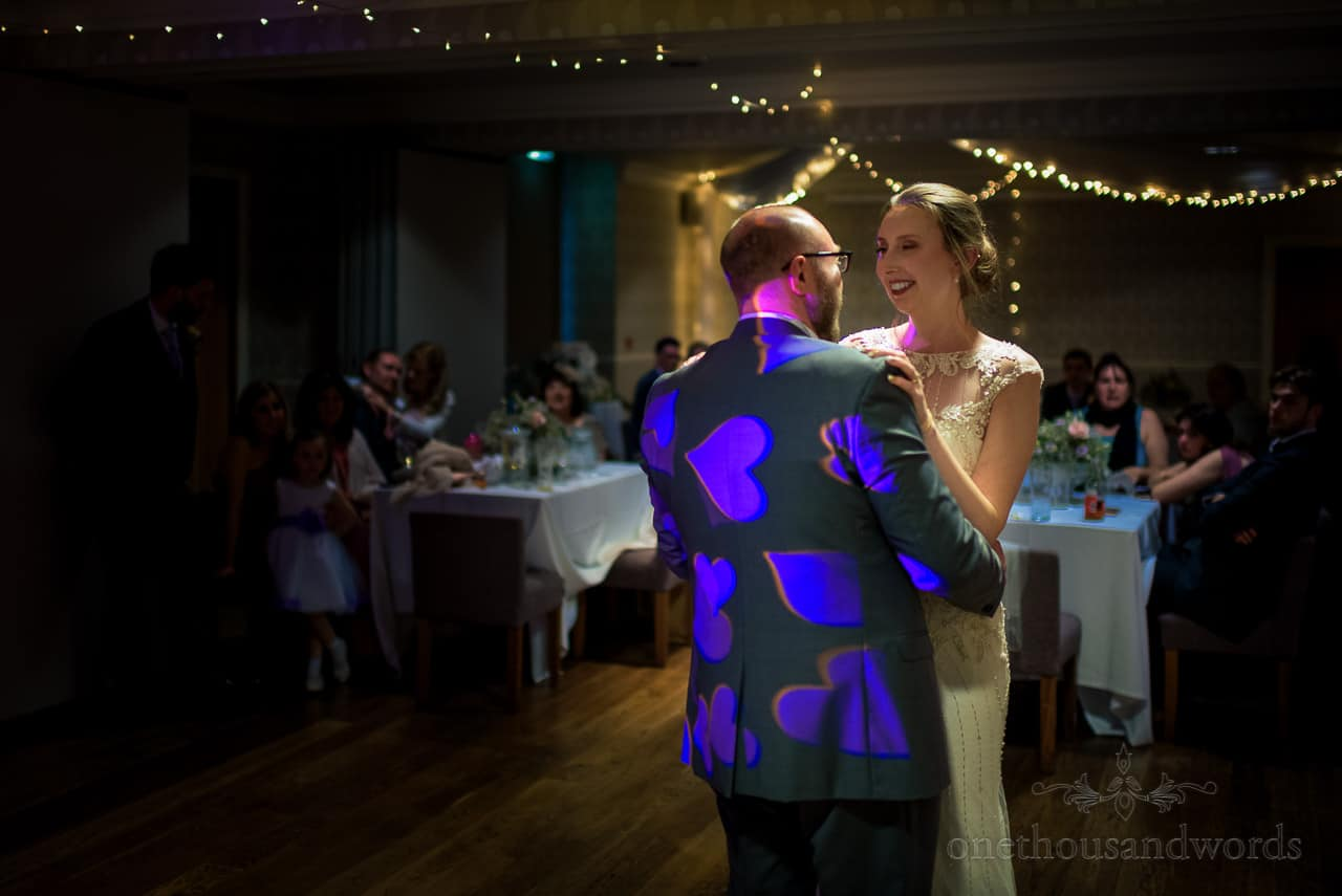 Bournemouth Hotel wedding first dance photo under fairy lights with projected love hearts