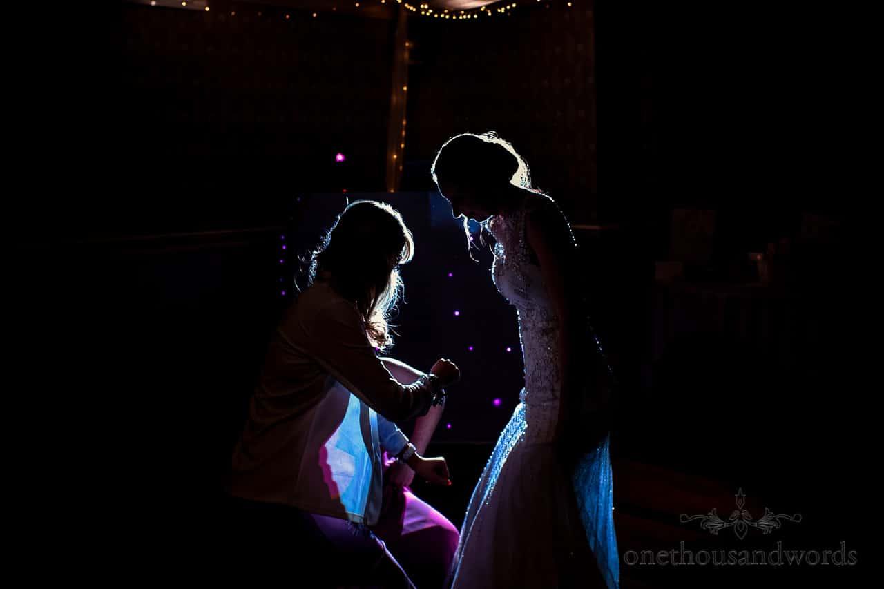 Bride and friends rim lit wedding dancing photograph