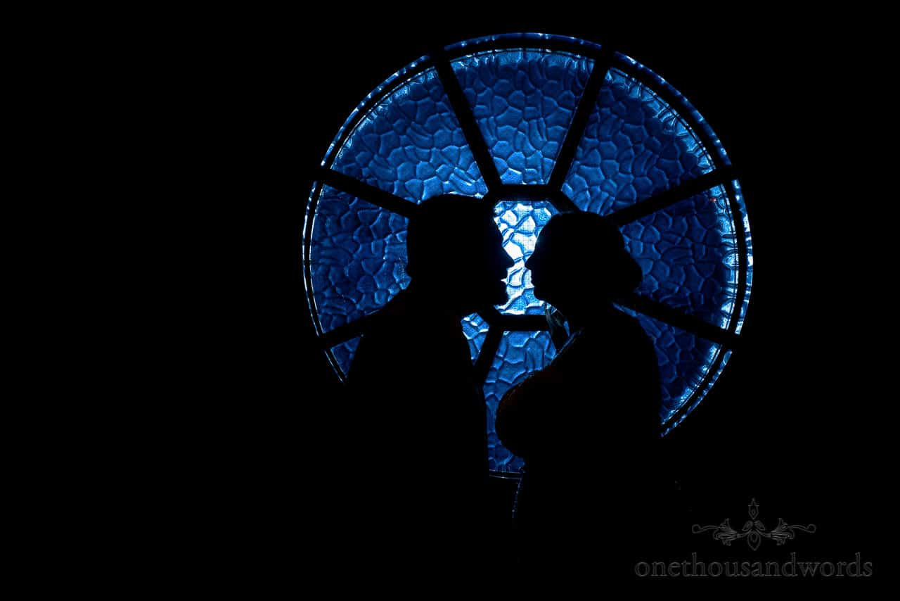 Bride and groom silhouettes with blue circular window at The Springfield Hotel wedding venue