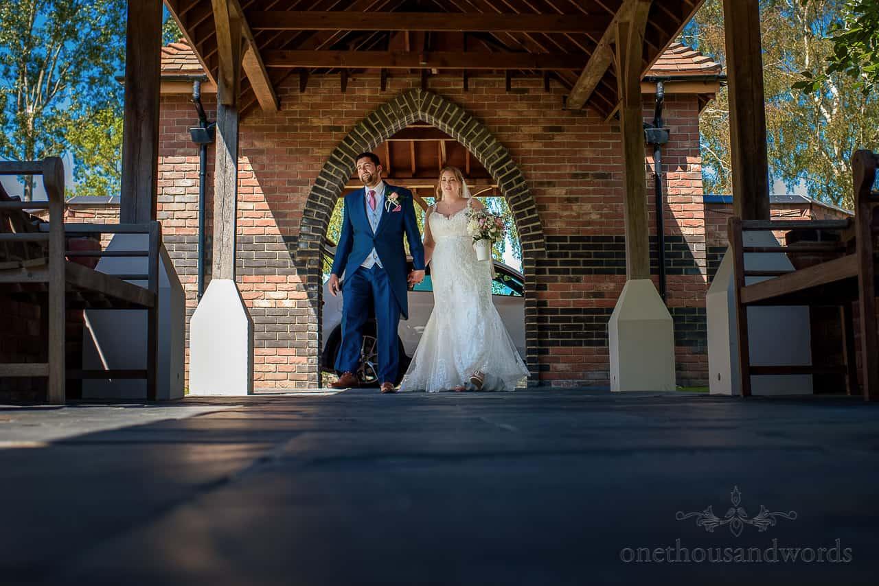 Bride and groom enter The Springfield Hotel wedding venue in Dorset