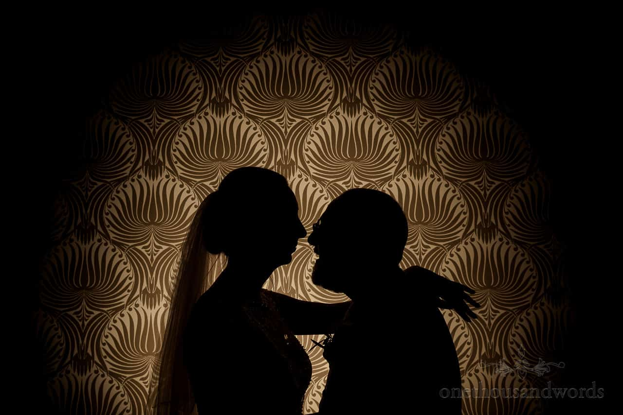 Bride and groom kissing silhouette photo against patterned wallpaper at The Green House Hotel in Bournemouth
