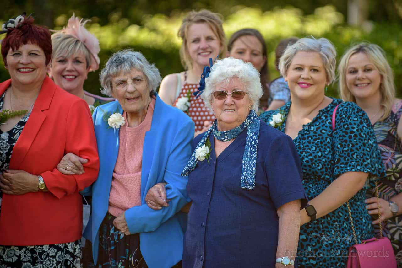 Brides grandmother at front of wedding group photograph