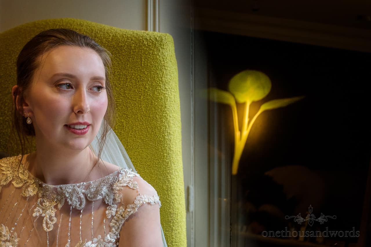 Bride portrait photo on green chair with reflection of green sprouting plant artwork