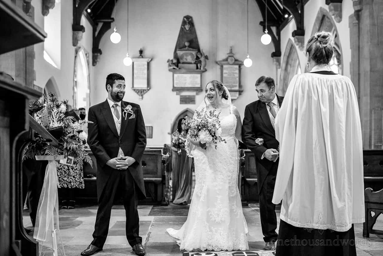 Expressive bride and groom first look photo in church wedding ceremony in Swanage, Dorset