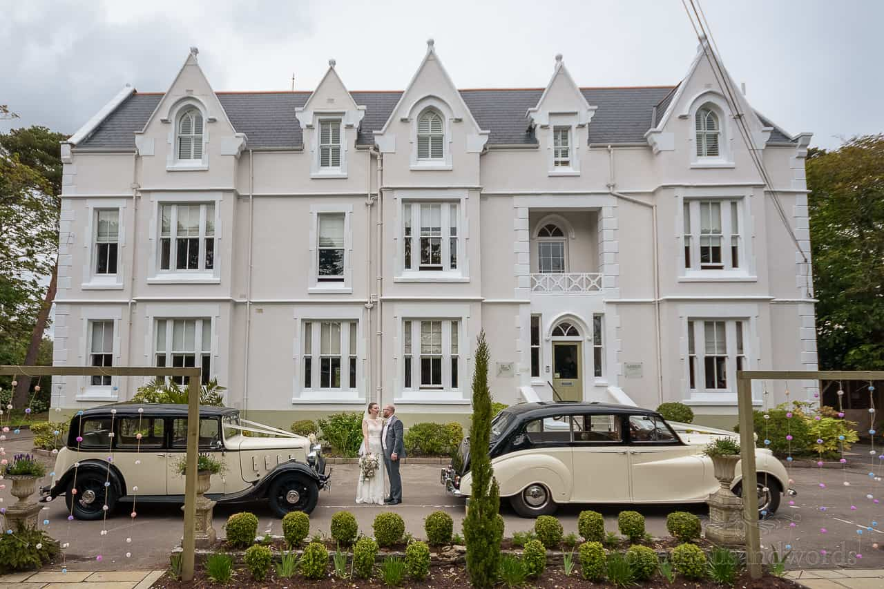 The Green House Hotel wedding venue in Bournemouth with bride and groom and classic wedding cars