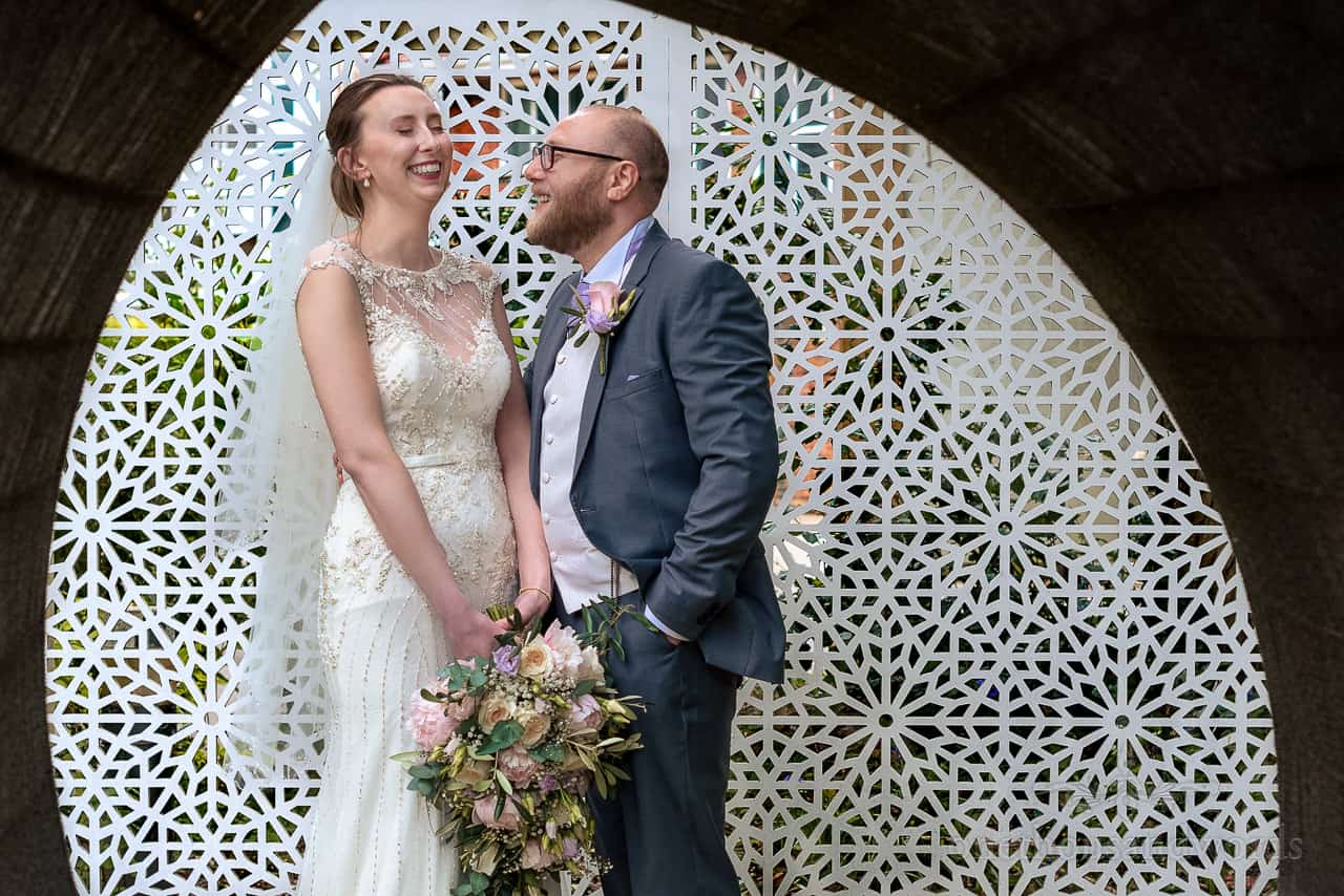 Laughing bride and groom couple photo at The Green House Hotel wedding venue in Bournemouth
