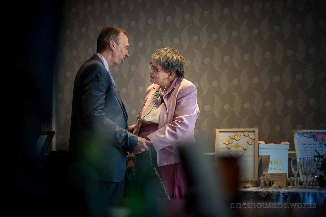 Mother and father of the bride share intimate moment in Bournemouth Hotel Foyer