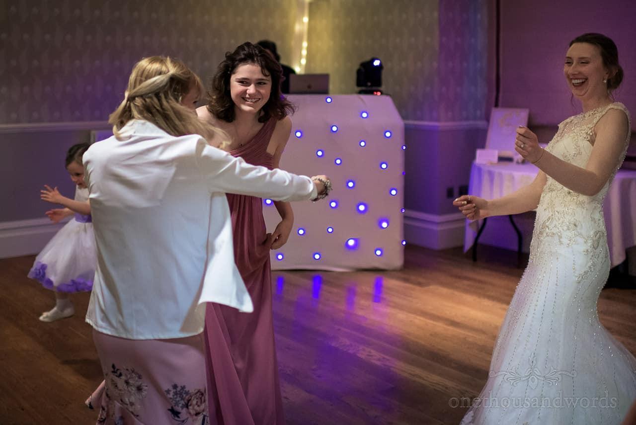 Socially distanced wedding dancing photograph