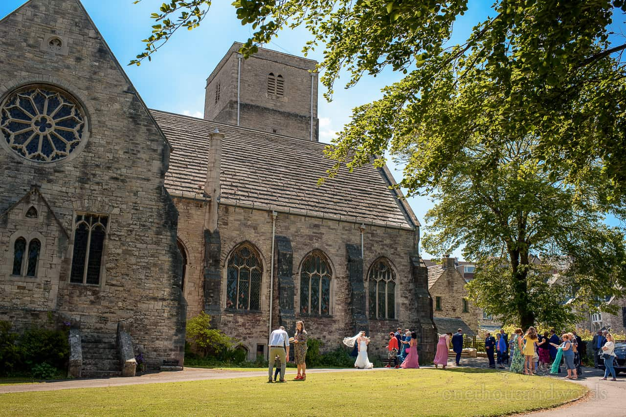 St Mary's Church, Swanage wedding venue with bride and wedding guests