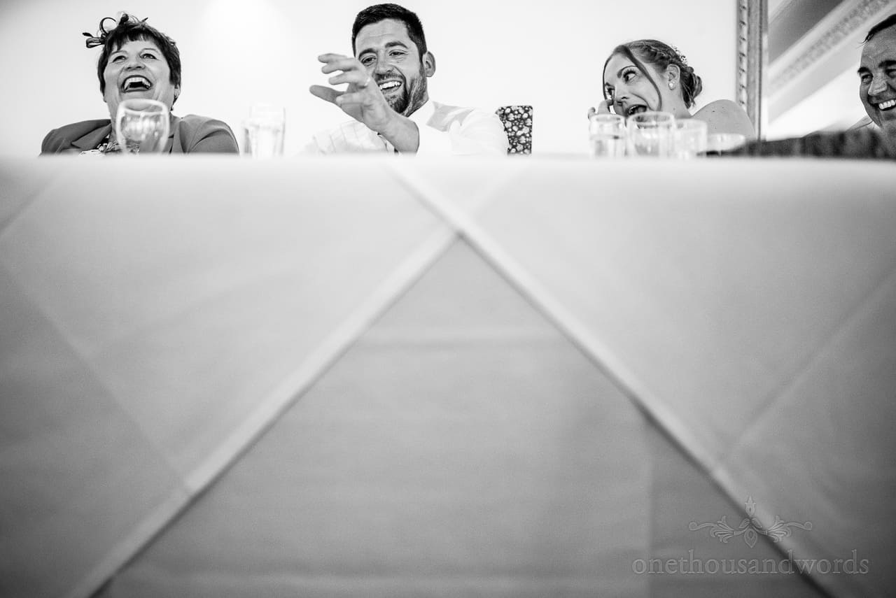 Top table laughing faces reactions during wedding speeches