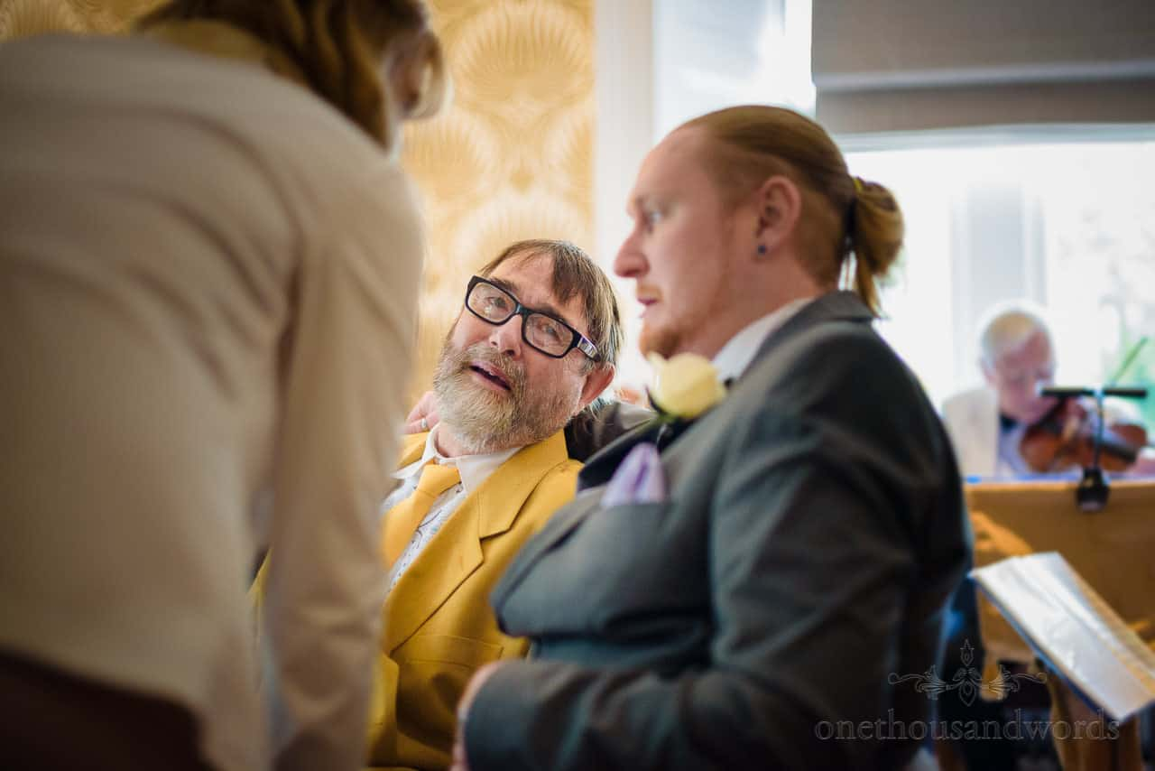 Emotional wedding guest photo at seated wedding drinks reception