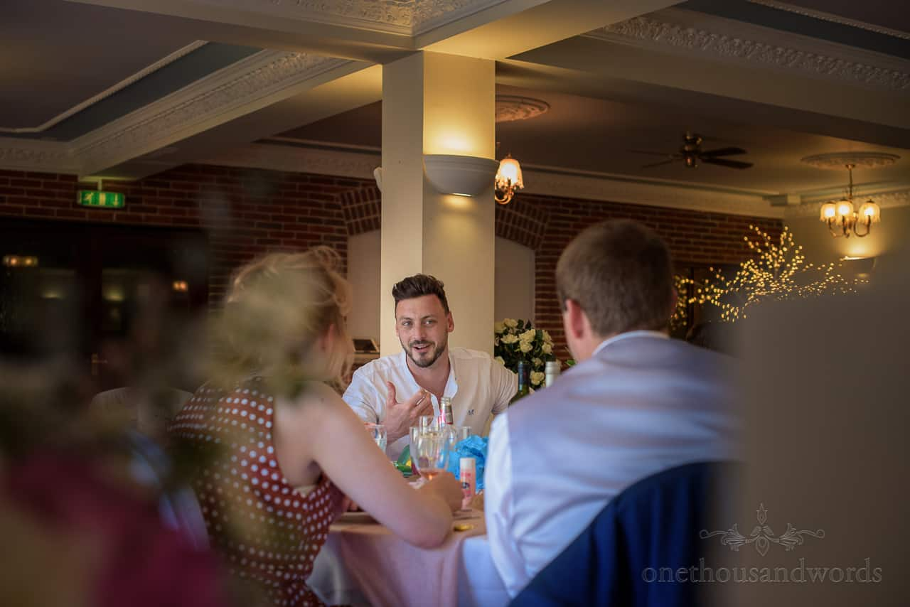 Wedding guest's animated conversation at Springfield Hotel wedding breakfast room