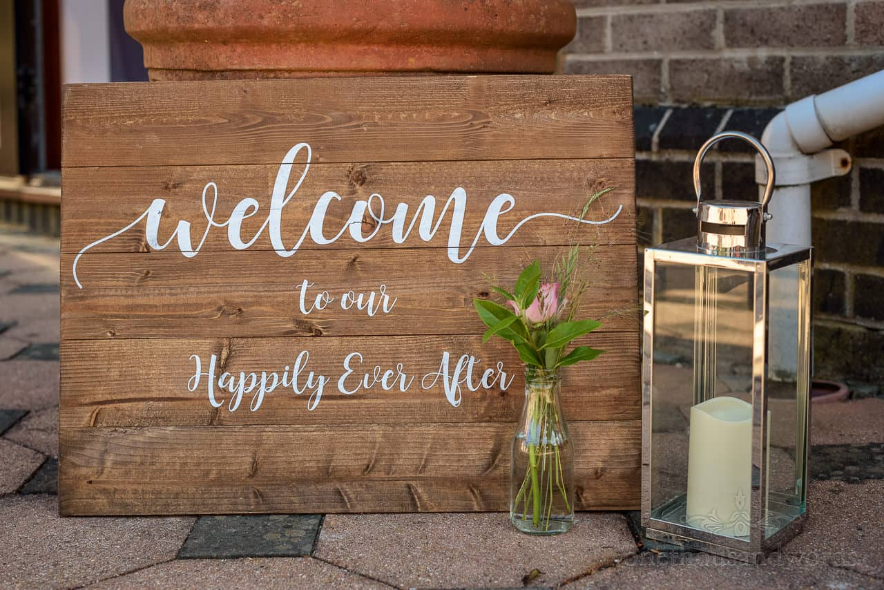 Wooden welcome to our happily ever after wedding sign decoration