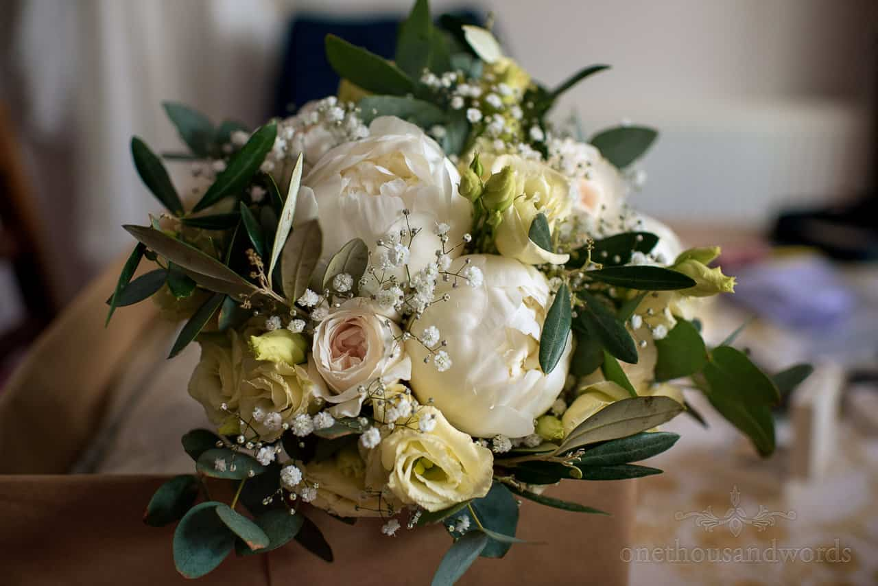 Yellow, green and pink wedding flowers bouquet close up photograph