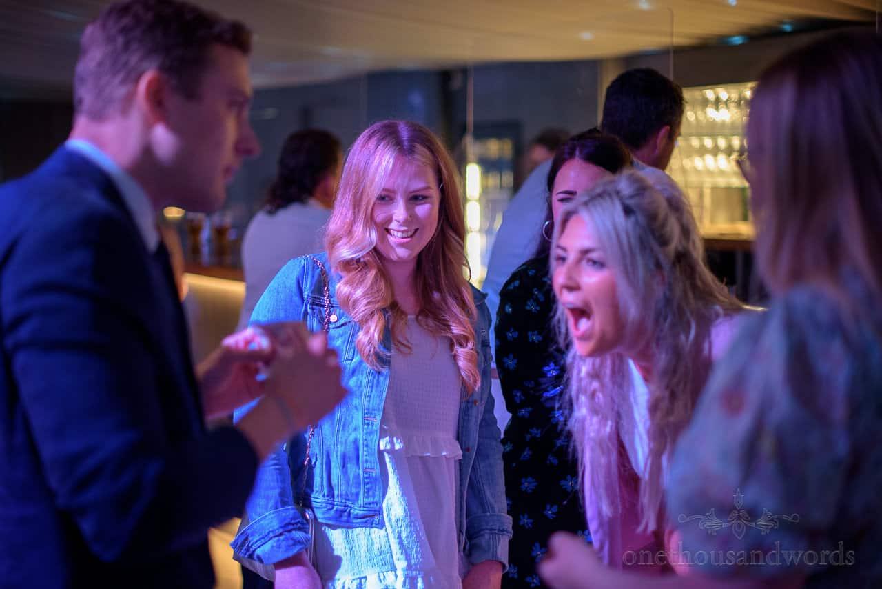 Iain Bailey wedding magician wows female wedding guests