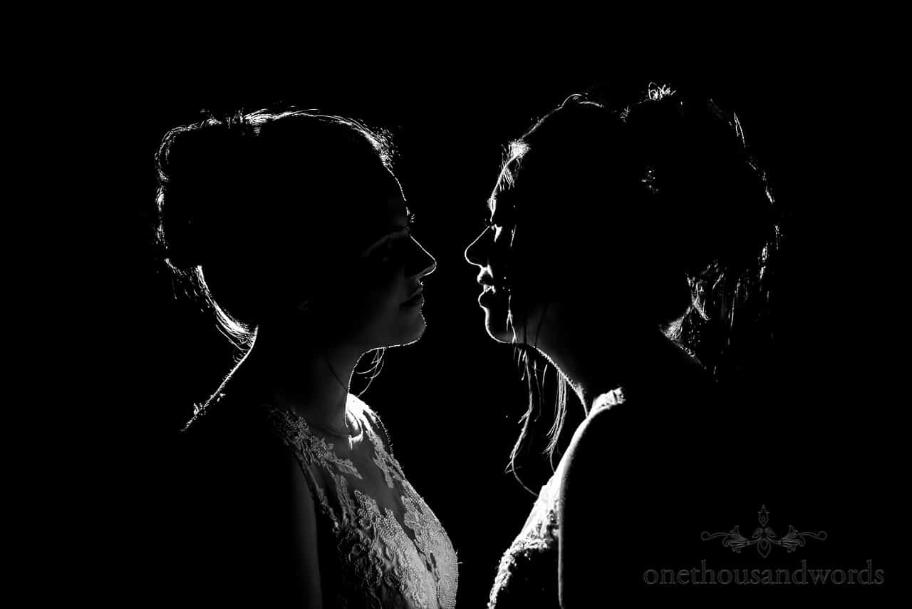 Black and white photo of intimate moment between brides