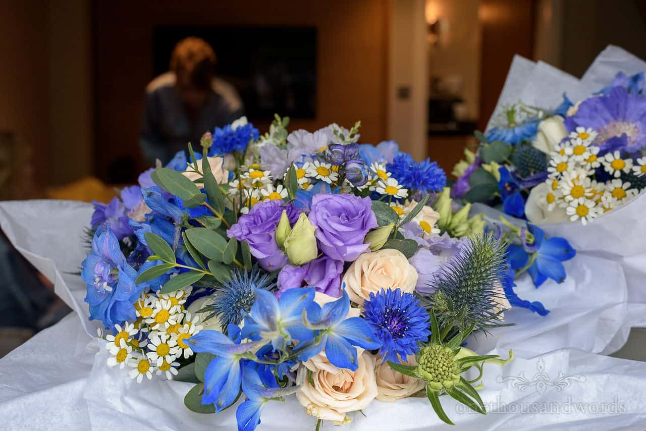 Blue, purple and wedding flowers bouquets photo
