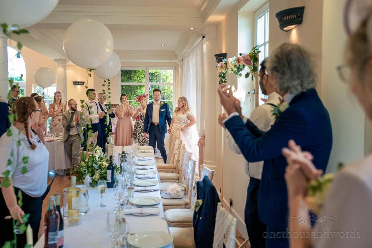 Bride and Groom enter Hethfelton House wedding breakfast to standing ovation