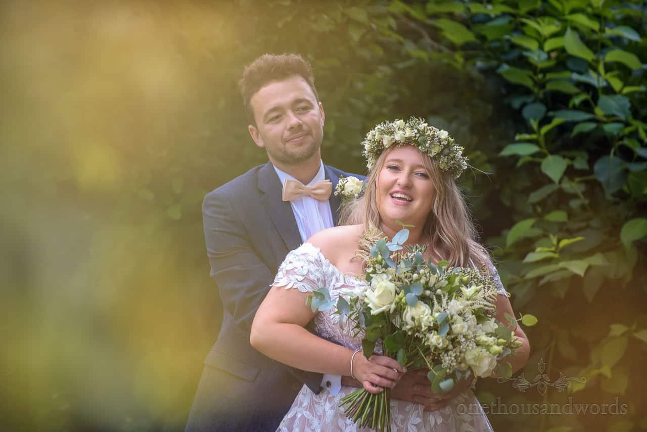 Bride and groom hugging couple photo at Hethfelton House gardens