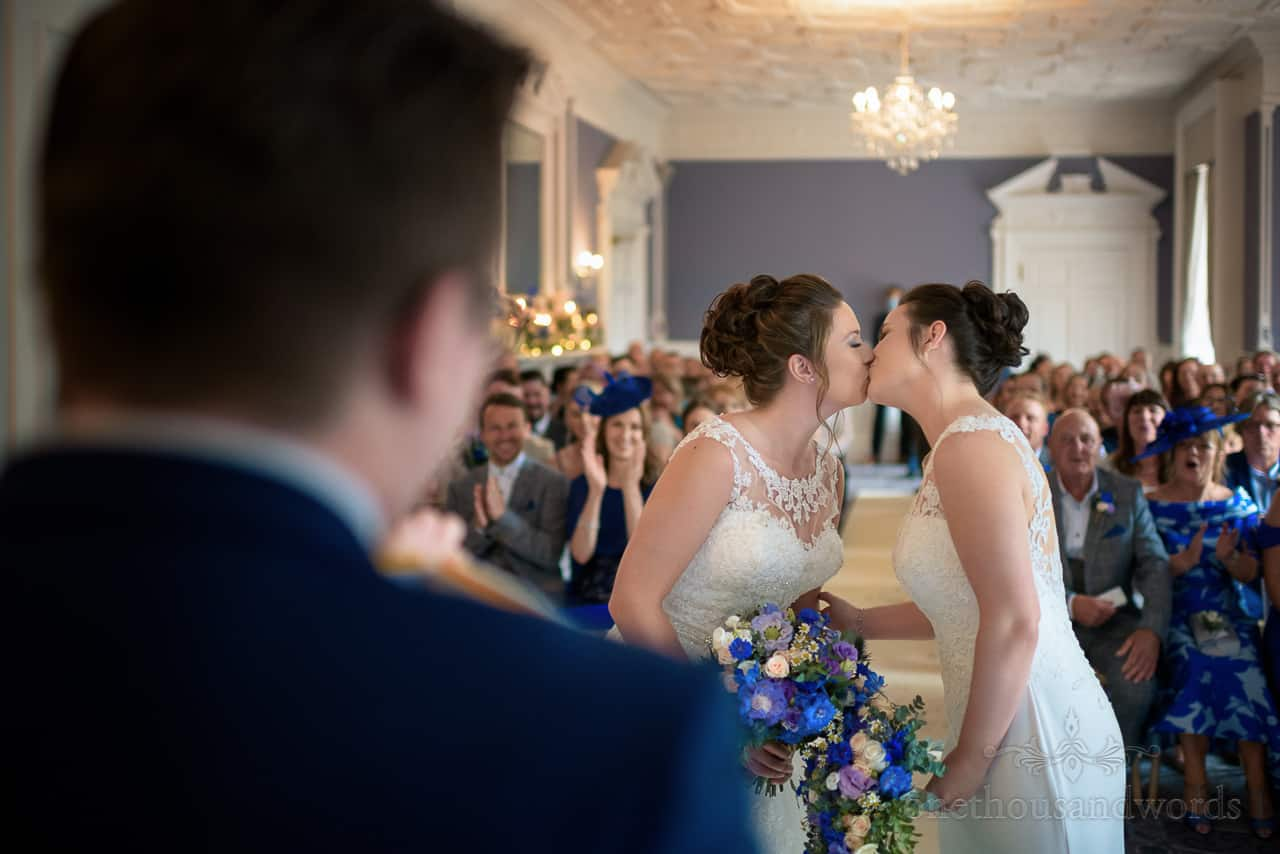 Bride's first kiss at same sex wedding ceremony at Oakley Hall wedding photos