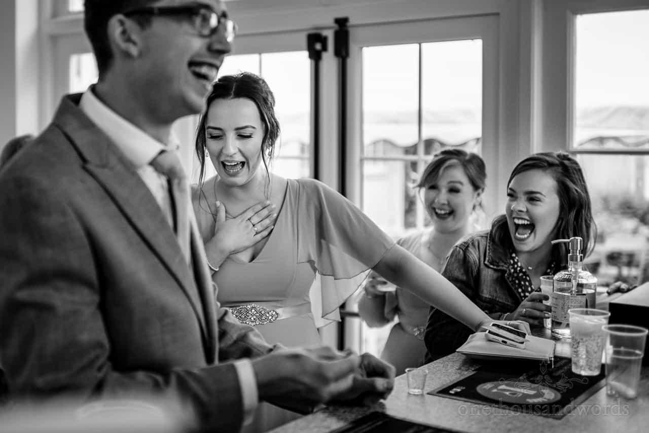 Wedding guest laughs at bridesmaids reaction to strong alcohol shots at the bar