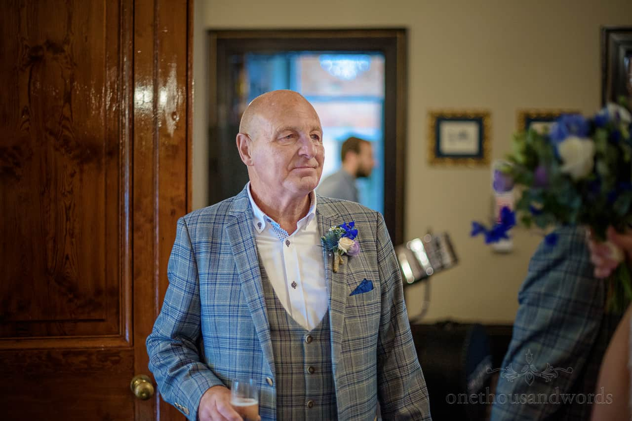 Crying emotional father of the bride at wedding drinks reception