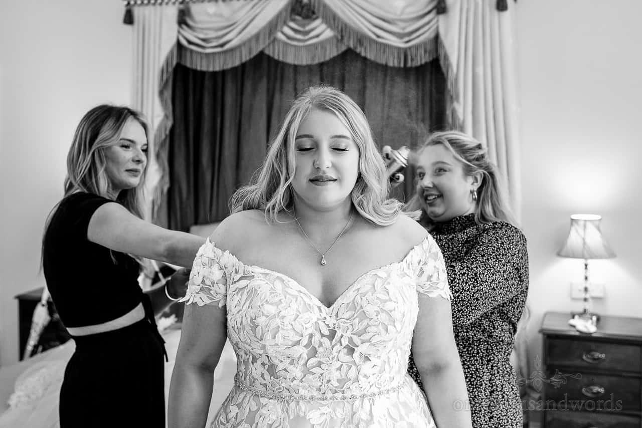 Documentary black and white bridal preparation wedding photo of bridal hair spray