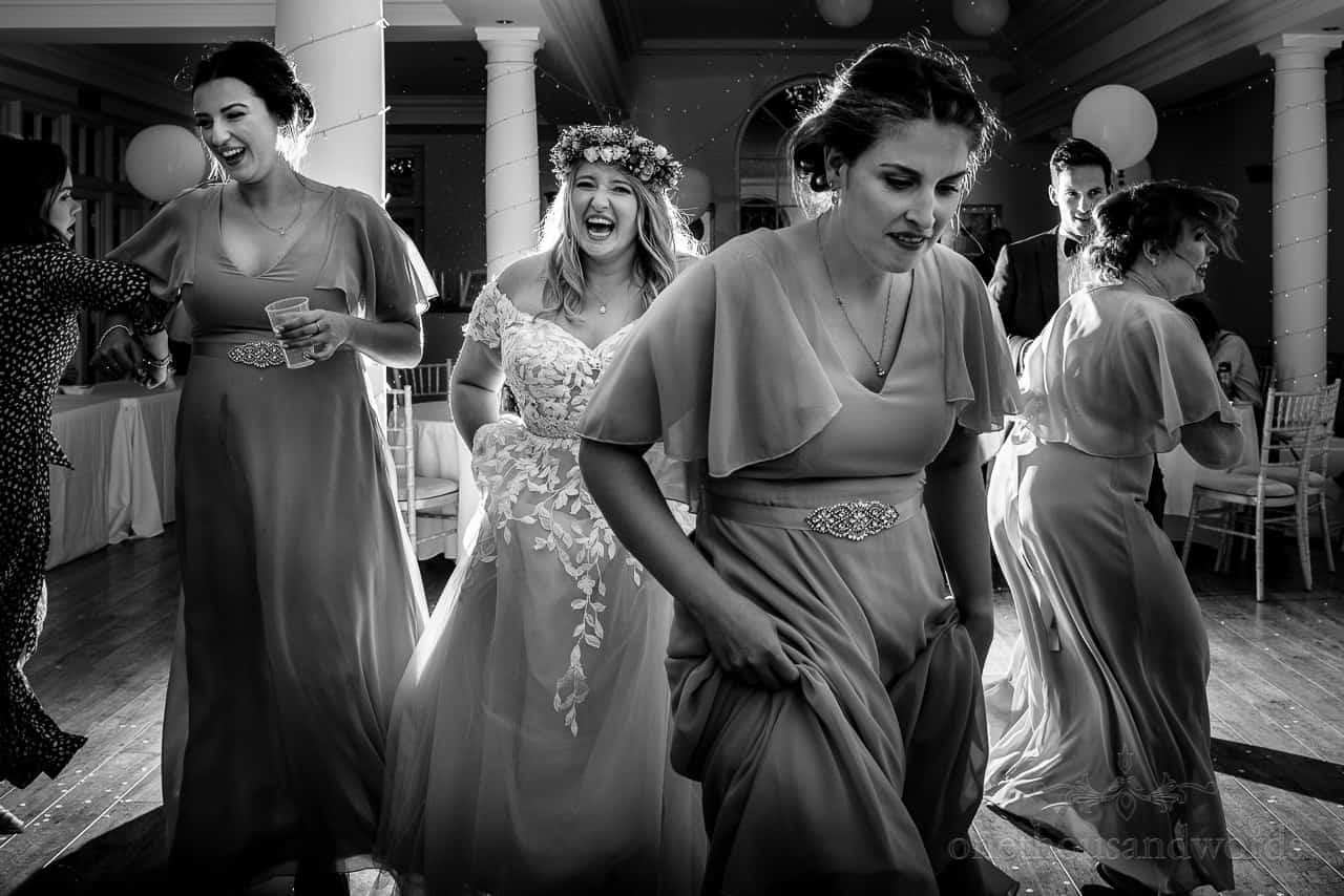 Documentary wedding Photo At Hethfelton House Of Bridesmaids Dancing