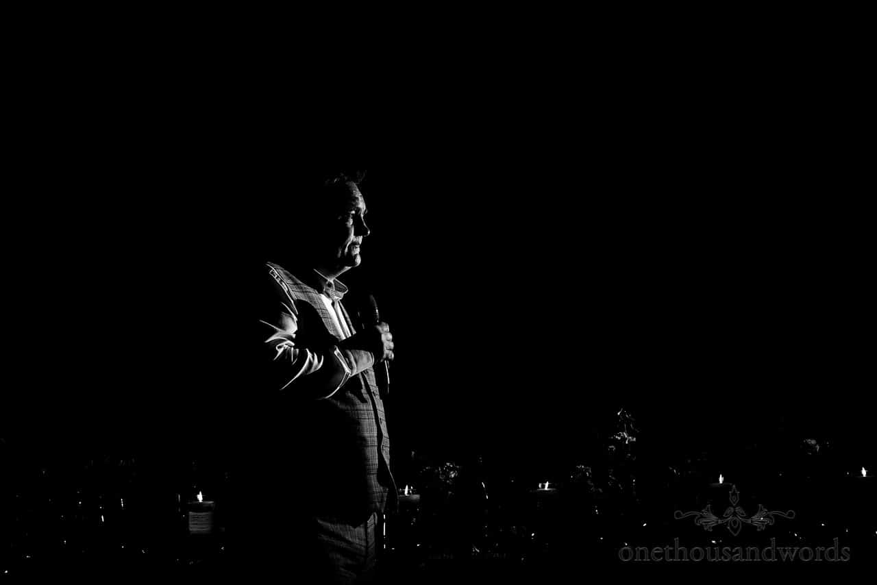 Emotional best man's wedding speech black and white photograph by documentary wedding photographers in Hampshire