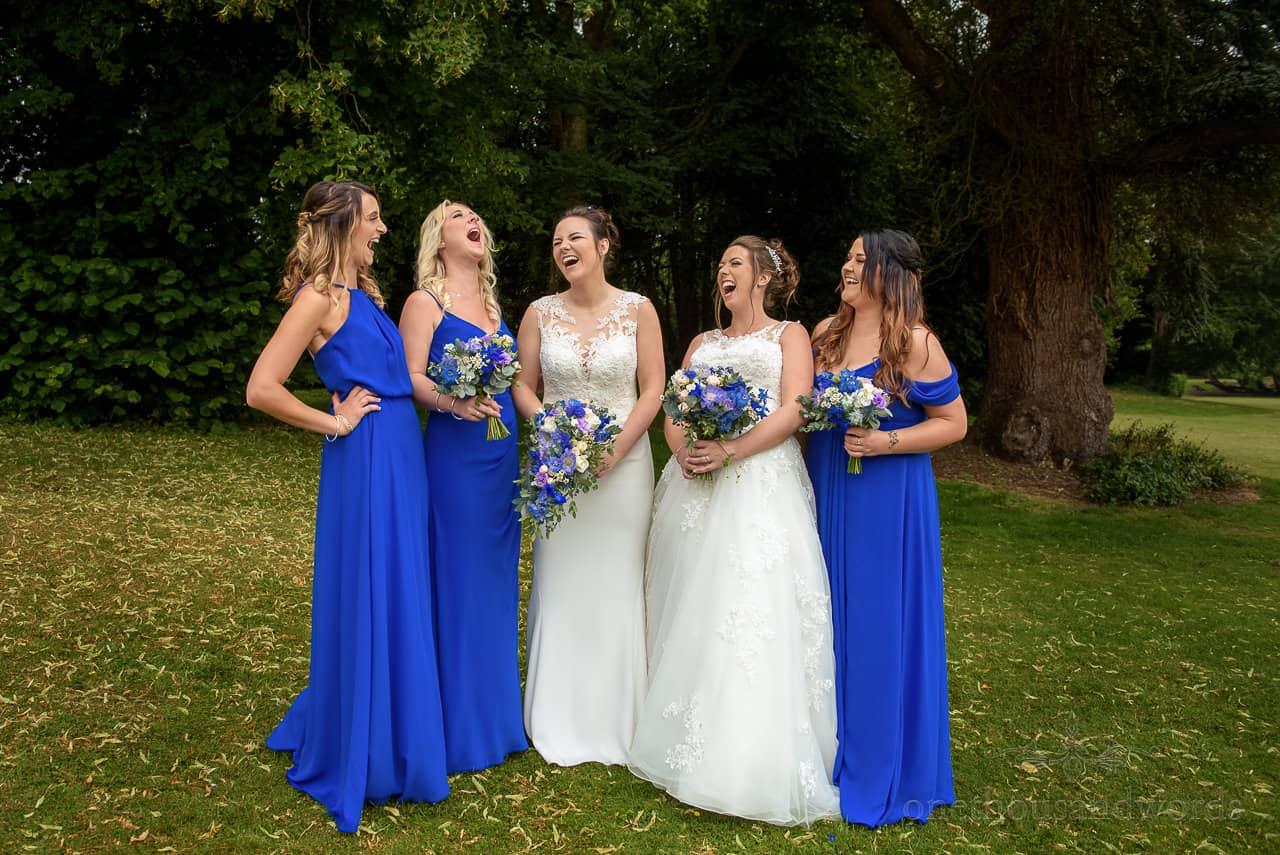 Laughing brides and bridesmaids group photograph
