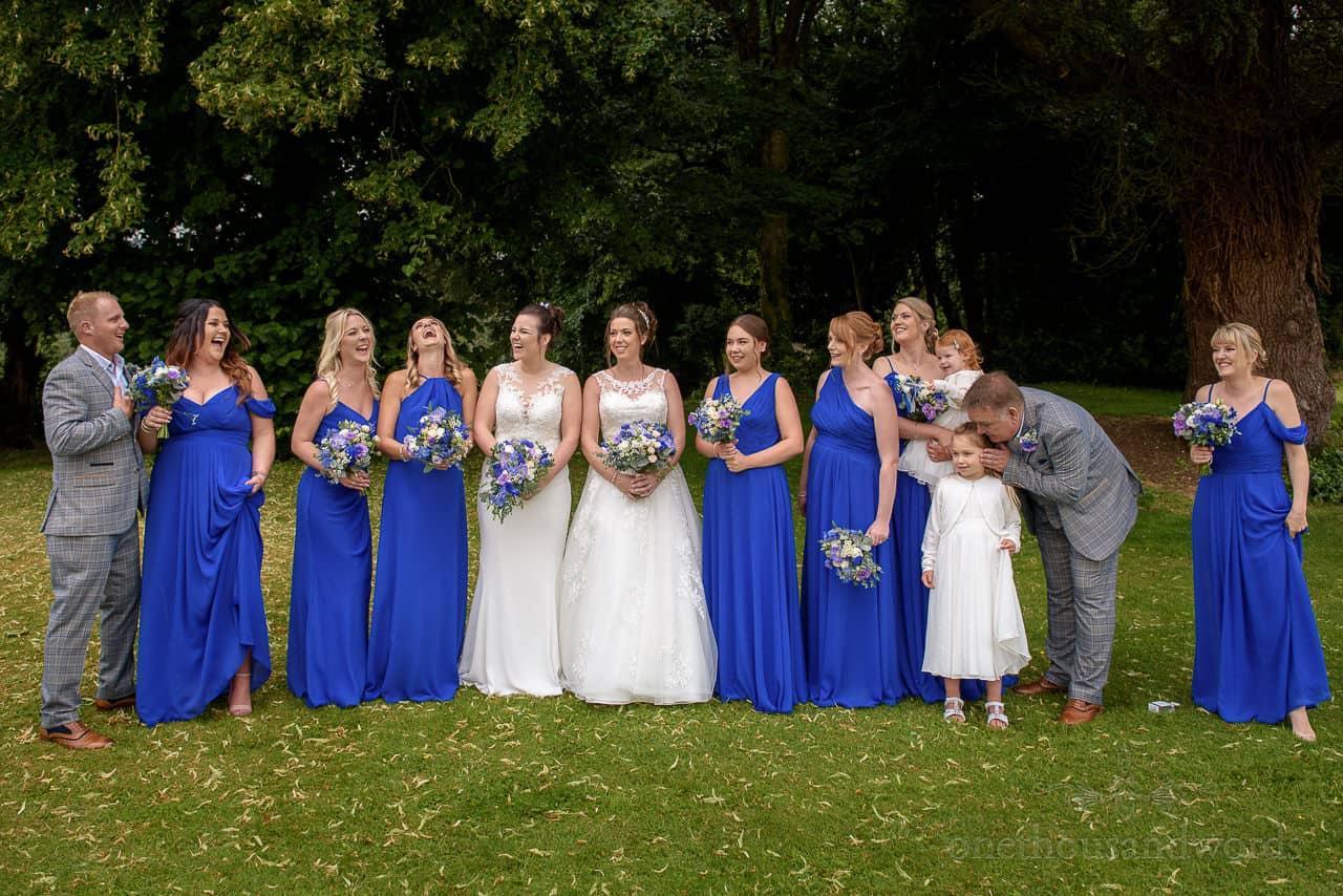 Laughing bridesmaids and bridesmen group photo
