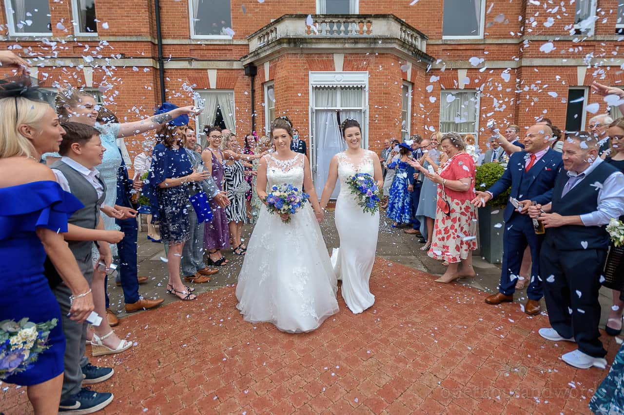 Oakley Hall wedding photos of confetti with two brides