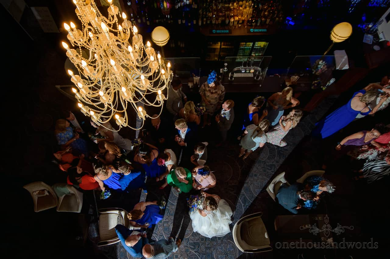 Oakley Hall wedding photos of drinks reception in foyer bar with chandelier
