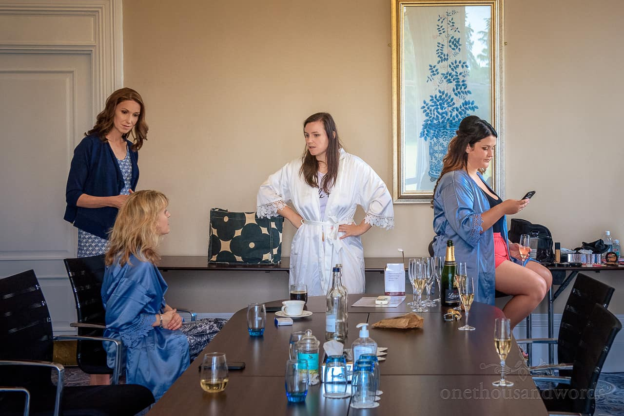 Serious faces on bride and bridal party during weddign mronign preparations at Oakley Hall wedding venue